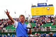 Ernie Els of South Africa holds the Claret Jug, 'The Golf Champion Trophy' in front of the scoreboard on the 18th green after winning the 2012 Open Championship at Royal Lytham and St Annes in Lytham. Els won the championship with a score of 273, one shot clear of Adam Scott of Australia