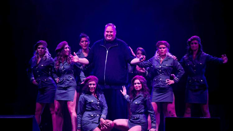 "Indicted Megaupload founder Kim Dotcom, center, poses with women during the launch of a new file-sharing website called ""Mega"" at his Coatesville mansion in Auckland, New Zealand, Sunday, Jan. 20, 2013. The colorful entrepreneur unveiled the site ahead of a lavish gala and press conference on the one-year anniversary of his arrest on racketeering charges related to his now-shuttered Megaupload file-sharing site. (AP Photo/New Zealand Herald, Richard Robinson) NEW ZEALAND OUT, AUSTRALIA OUT"