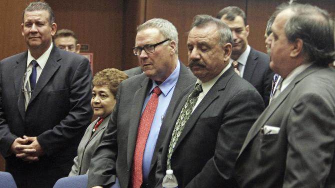 FILE - This  Jan. 24, 2013 file photo,  former Bell, Calif., city officials appear for a massive city corruption trial in a downtown Los Angeles courtroom. Verdicts have been reached in the trial of six former elected officials of the tiny Los Angeles County city of Bell.  A Superior Court spokeswoman says the verdicts will be read Wednesday, March 20, 2013.  The former mayor and five other ex-officials are accused of misappropriation of public funds by giving themselves enormous salaries. (AP Photo/Los Angeles Times, Francine Orr, Pool,File)