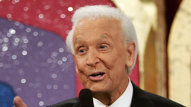 "FILE - In this June 6, 2007 file photo shows game show host Bob Barker gesturing during the taping of his final episode of ""The Price Is Right"" in Los Angeles. The 40th anniversary special of the popular daytime game show aired Tuesday, Sept. 4, 2012 on CBS. (AP Photo/Damian Dovarganes, file)"