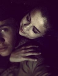 Justin Bieber and Selena Gomez are seen cuddling up on January 3, 2014 -- Instagram