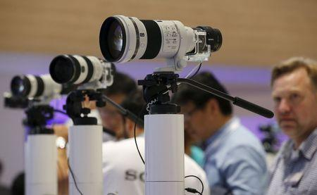 File photo of Sony camera lenses with attached lens-like cameras ILCE-QX1 with 20.1MP sensors at the IFA consumer technology fair in Berlin