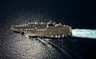 The USS Abraham Lincoln aircraft carrier transits through the Arabian Sea in April 2012. The United States has moved new forces into the Gulf to keep strategic waterways open and strike deep within Iran in the event of a regional military escalation, according to the New York Times