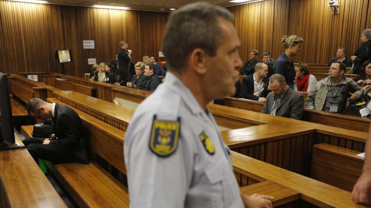 Olympic and Paralympic track star Pistorius sits in the dock during court proceedings at the North Gauteng High Court in Pretoria