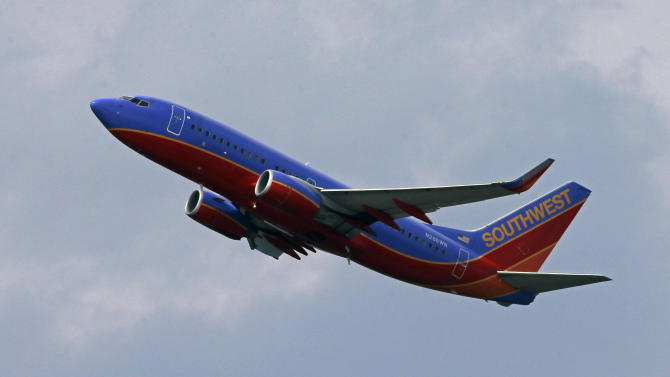 In this Tuesday, July 23, 2013, photo, a Southwest Airlines jet taking off from Pittsburgh International Airport in Imperial, Pa. Southwest reports quarterly earnings on Thursday, July 25, 2013. (AP Photo/Gene J. Puskar)