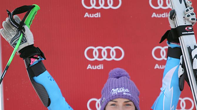 Slovenia's Tina Maze celebrates on podium after taking second place in an alpine ski, women's World Cup giant slalom, in Maribor, Slovenia, Saturday, Jan. 26, 2013. (AP Photo/PierMarco Tacca)