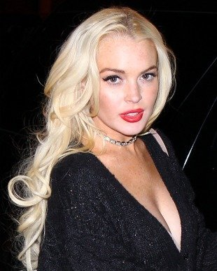 Lohan's publicist, Steve Honig, confirmed reports she's posing in the nude, ...