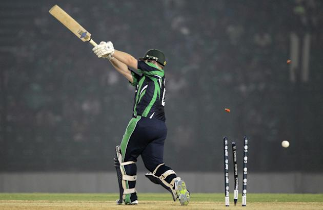 The bails fly off the wickets resulting in the dismissal of Ireland's Paul Stirling during a warm-up cricket match against Nepal ahead of the Twenty20 World Cup Cricket in Fatullah, near Dhaka, Bangla