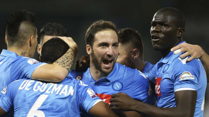 Napoli's Higuain celebrates after scoring a goal during their Italian Super Cup soccer match against Juventus at Al-Sadd Stadium, in Doha