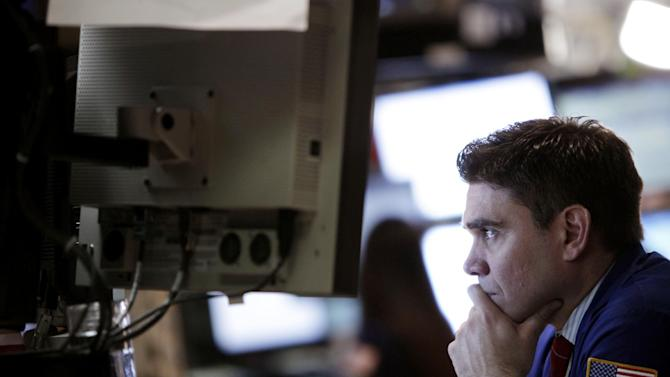 FILE - In this Tuesday, Feb. 21, 2012 file photo, a trader works on the floor at the New York Stock Exchange in New York. (AP Photo/Seth Wenig)