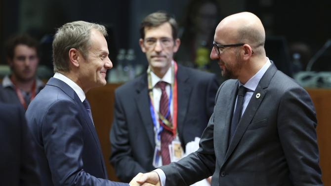 EU Council President Tusk welcomes Belgium's PM Michel during a EU leaders summit in Brussels