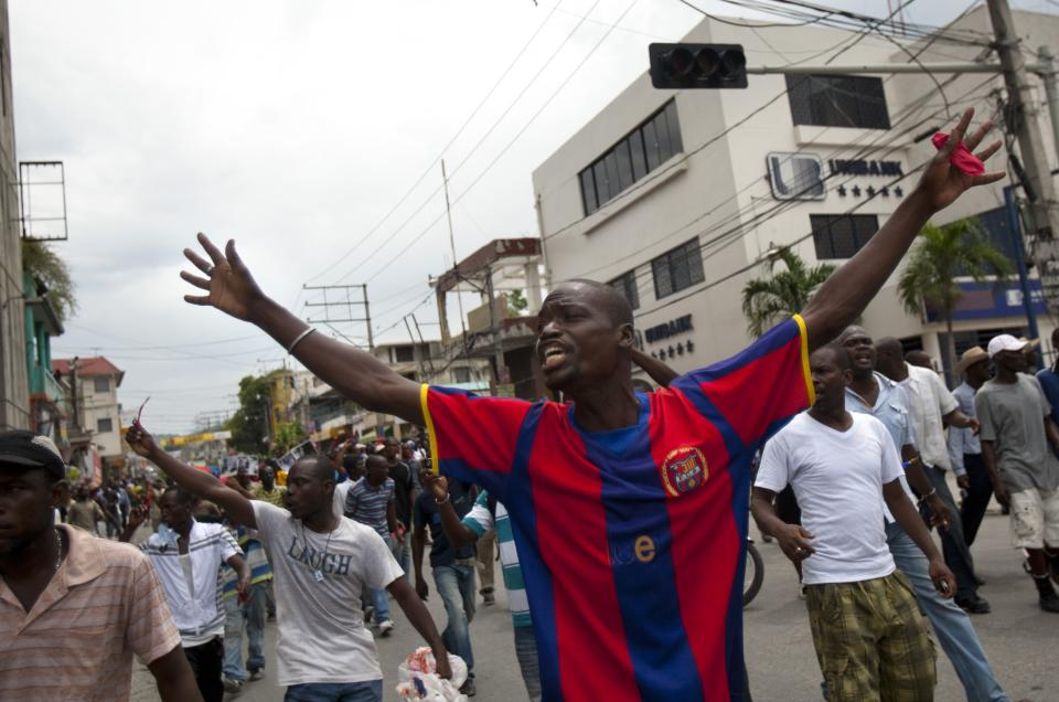 People demonstrate during a protest against Haiti's President Michel Martelly government in Port-au-Prince, Haiti, Sunday, Sept. 30, 2012. (AP Photo/Dieu Nalio Chery)