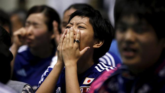 Japan's soccer fans react after the first goal by the U.S. against Japan at the Women's World Cup final soccer match in Vancouver, at a public viewing event in Tokyo, Japan