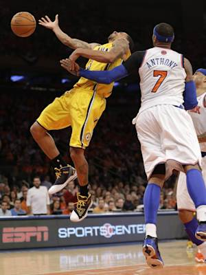 New York Knicks forward Carmelo Anthony (7) fouls Indiana Pacers guard George Hill (3) in the second quarter of Game 1 of their second-round NBA basketball series at Madison Square Garden in New York, Sunday, May 5, 2013.  (AP Photo/Kathy Willens)