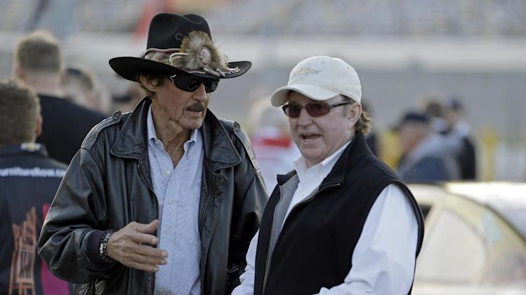 Team owners Richard Petty left, and Richard Childress talk in the garage area during a practice for the NASCAR Sprint Unlimited Shootout auto race at Daytona International Speedway, Friday, Feb. 15, 2013, in Daytona Beach, Fla. (AP Photo/John Raoux)