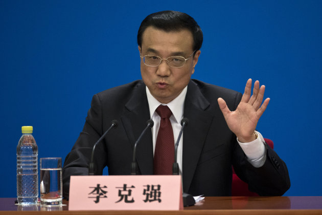FILE - In this March 17, 2013 file photo, China's newly-named Premier Li Keqiang speaks during a press conference after the closing ceremony of the National People's Congress held in Beijing's Great H