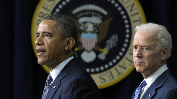 FILE - In this Jan. 16, 2013 file photo, President Barack Obama, accompanied by Vice President  Joe Biden, talks about proposals to reduce gun violence, in the South Court Auditorium at the White House in Washington. President Barack Obama is bringing 11 relatives of those killed in the shooting at Connecticut's Sandy Hook Elementary School to Washington on Air Force One Monday so they can personally encourage senators to back gun legislation that faces tough opposition.  (AP Photo/Susan Walsh, File)