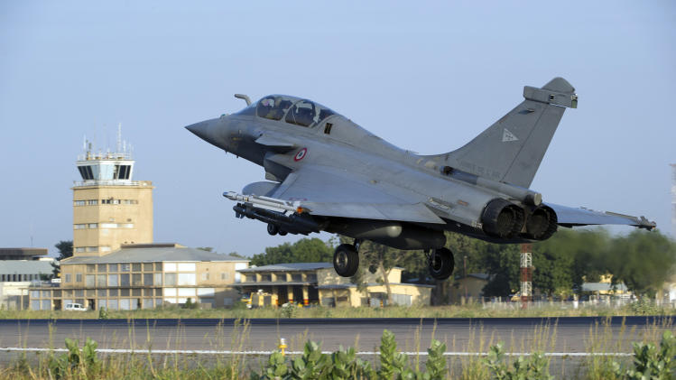 This Sunday Jan.13, 2013 photo provided by the French Army Monday Jan.14, 2013 shows a  French Rafale jetfighter landing after a mission to Mali in N'Djamena, Chad. French fighter jets bombed rebel targets in a major city in Mali's north Sunday, pounding the airport as well as training camps, warehouses and buildings used by the al-Qaida-linked Islamists controlling the area, officials and residents said. (AP Photo/Adj Nicolas-Nelson Richard, ECPAD)