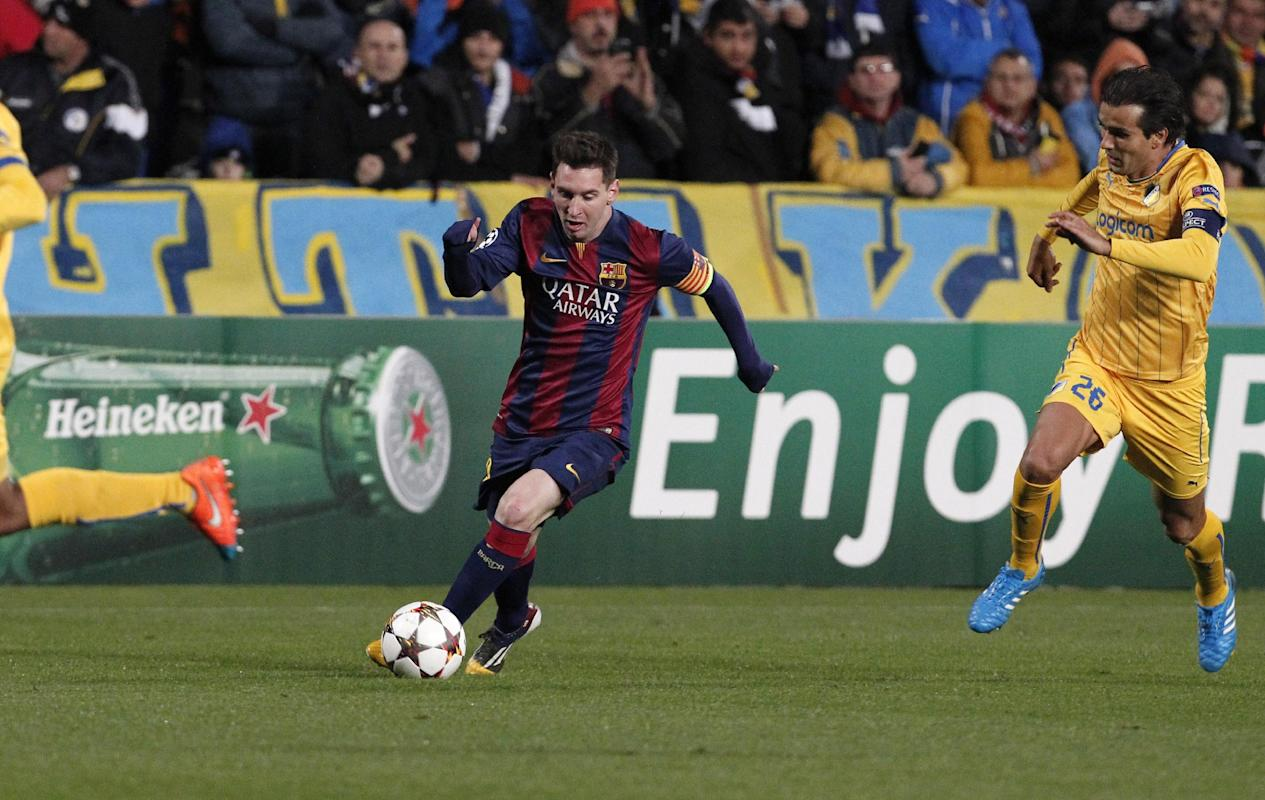 Barcelona's Lionel Messi fights for the ball with APOEL's Barbosa during a Champions League Group F soccer match between APOEL and FC Barcelona at GSP stadium, in Nicosia, Cyprus, Tuesday, Nov. 25, 2014