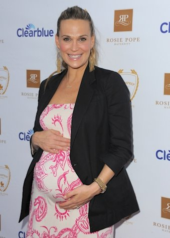 Molly Sims show off her baby bump at the Rosie Pope Maternity Store Opening Event at Rosie Pope Maternity in Santa Monica, Calif. on March 29, 2012  -- Getty Premium