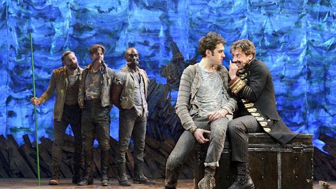 "In this theater image released by The O & M Co., from left,  Matt D'Amico, Rick Holmes, Isaiah Johnson, Adam Chanler-Berat, and Christian Borle are shown in a scene from ""Peter and the Starcatcher,"" performing at the brooks Atkinson Theatre in New York. Producers of the play ""Peter and the Starcatcher"" said Wednesday, Jan. 2, 2013, that the production will have a new life after it vacates the Brooks Atkinson Theatre later this month. It will be produced this spring at New World Stages, an off-Broadway complex of theaters that has housed other former Broadway shows like ""Avenue Q,"" ""Million Dollar Quartet"" and ""Rent."" (AP Photo/The O & M Co.)"