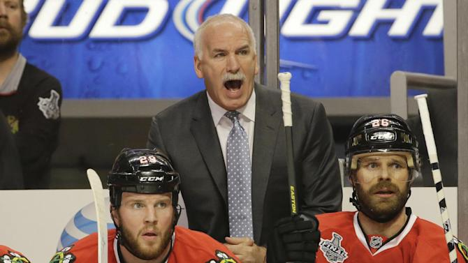 Chicago Blackhawks head coach Joel Quenneville directs his team during the first period of Game 1 in their NHL Stanley Cup Final hockey series against the Boston Bruins, Wednesday, June 12, 2013, in Chicago. (AP Photo/Nam Y. Huh)