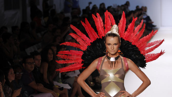 A model wears swimwear from the collection of  Red Carter during the Mercedes-Benz Fashion Week Swim 2013 show, Sunday, July 22, 2012, in Miami Beach, Fla. (AP Photo/Lynne Sladky)