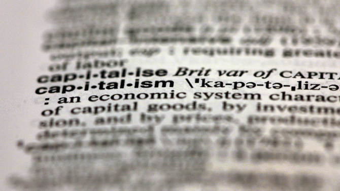 The word capitalism, from the 11th edition of Merriam-Webster's Collegiate Dictionary, is shown in this photograph, in New York,  Wednesday, Dec. 5, 2012.  Thanks to the election, socialism and capitalism are forever wed as Merriam-Webster's most looked-up words of 2012. (AP Photo/Richard Drew)