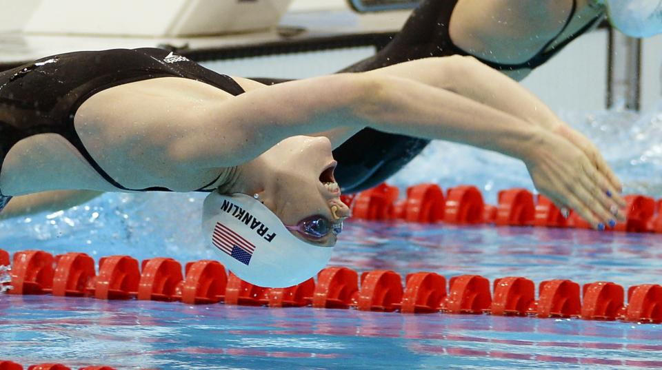 United States' Missy Franklin starts in a women's 100-meter backstroke swimming heat at the Aquatics Centre in the Olympic Park during the 2012 Summer Olympics in London, Sunday, July 29, 2012. (AP Photo/Mark J. Terrill)