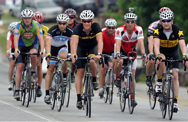 Lance Armstrong (center) leads the pack coming to Jack's restaurant in Pleasant Grove, Ala., Friday, April 27, 2012,,  on the fourth day of the Bo Bikes Bama charity bike ride on the one-year anni