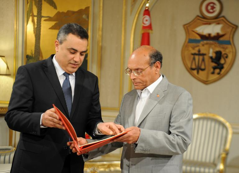 Tunisia gets new constitution and caretaker cabinet