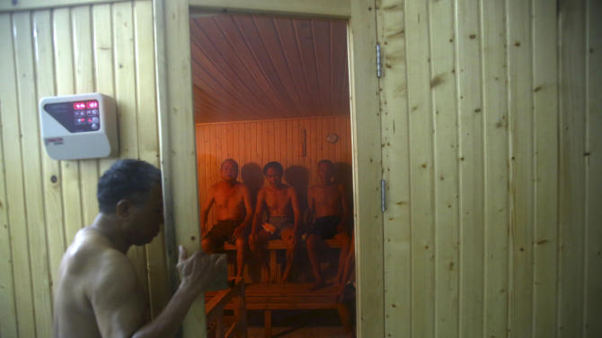 In this photo taken on March 18, 2013, a patient enters a sauna room at the Scientology Health Center of the Vietnam Association of Agent Orange Victims in Thai Binh, Vietnam. The center runs a 25-day health program which, as well as massive consumption of vitamins, includes four-hour sauna sessions and a morning run. While there is no medical evidence that the treatment at the center is effective, Vietnamese authorities are supporting it as a way of relieving some of the suffering of the between 2 and 4 million people suffering from illnesses linked to exposure to Agent Orange during the war. (AP Photo/Na Son Nguyen)