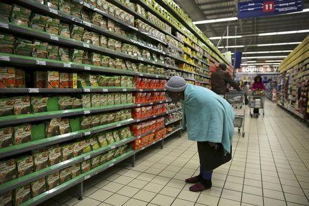 A shopper browses in a branch of South African retailer Pick n Pay at a mall in Soweto