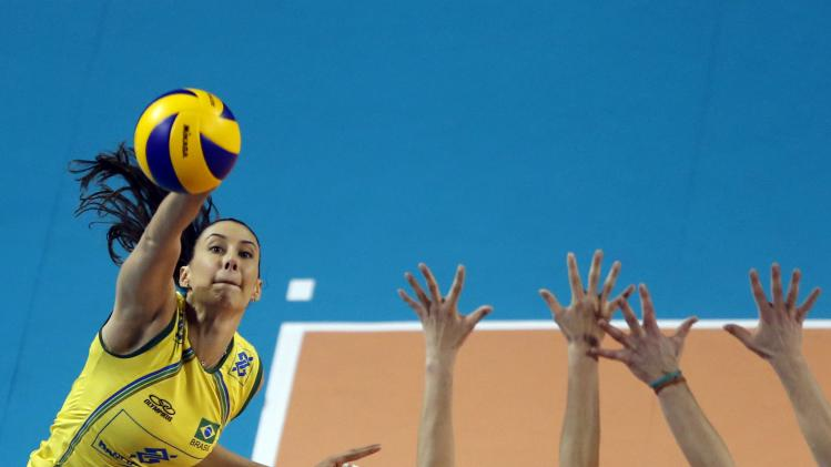Sheilla Castro of Brazil spikes the ball against Charlotte Leys and Freya Aelbrecht of Belgium during their FIVB Women's Volleyball World Grand Prix 2014 final round match in Tokyo