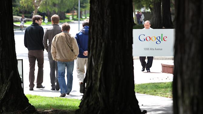 Google workers walk outside of Google headquarters in Mountain View, Calif., Thursday, April 12, 2012. Google Inc. said Thursday that it earned $2.89 billion, or $8.75 per share, in the first quarter. That's up from $1.8 billion, or $5.51 per share, a year earlier. (AP Photo/Paul Sakuma)