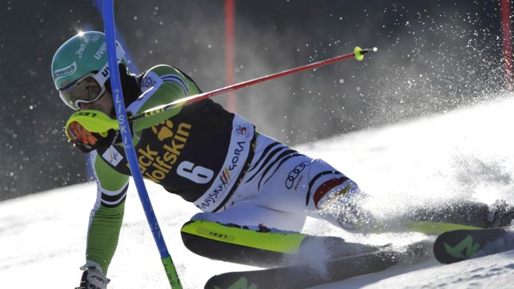 Neureuther of Germany clears a gate during the first run of the Alpine Skiing World Cup men's slalom ski race in Kranjska Gora