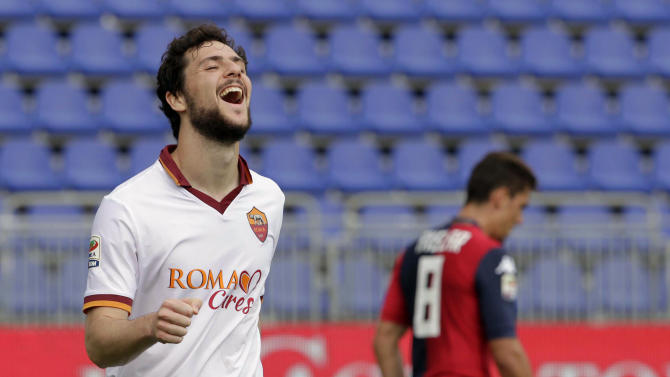 Roma's Mattia Destro celebrates after scoring during a Serie A soccer match between Cagliari and Roma in Cagliari, Italy, Sunday, April 6, 2014. Roma moved within five points of Serie A leader Juventus as Mattia Destro scored his first-ever hat trick in a 3-1 win at Cagliari on Sunday. (AP Photo/Max Solinas)