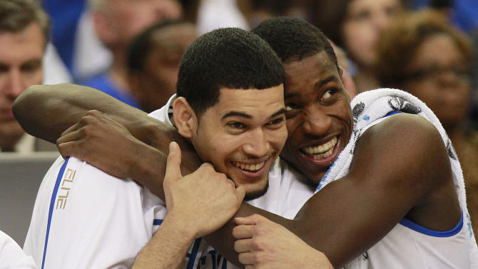 Kentucky's Eloy Vargas, left, and Darius Miller reacts in the closing seconds of the NCAA tournament South Regional final college basketball game against Baylor on Sunday, March 25, 2012, in Atlanta. Kentucky won 82-70. (AP Photo/John Bazemore)
