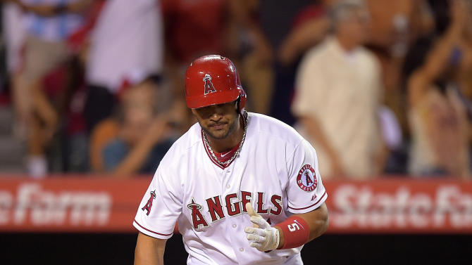 Angels top Astros 11-5 with 3 HRs in 8-run 7th