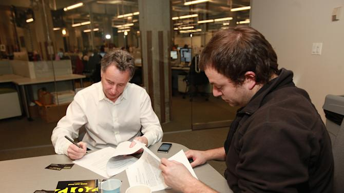 IMAGE DISTRIBUTED FOR BRIGHT FUTURE INTERNATIONAL - Anthony Melikhov, left, founder of Bright Future International and Frank Pinto, founder of Meet Mantra, sign a deal at Light Bank Headquarters to develop and launch a new social innovation platform worldwide, on Monday, Feb. 25, 2013 in Chicago, Illinois. (Photo by Barry Brecheisen/Invision for Bright Future International/AP Images)