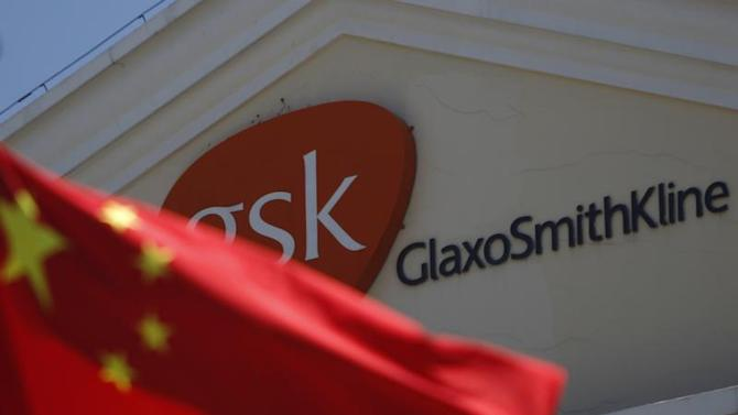 A Chinese national flag is seen in front of a GlaxoSmithKline office building in Shanghai