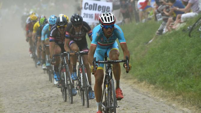 Astana rider Nibali of Italy cycles on a cobble-stoned section during the 4th stage of the 102nd Tour de France cycling race from Seraing to Cambrai