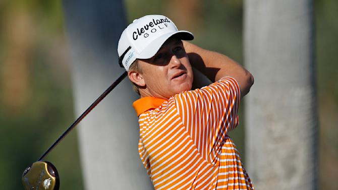 David Toms watches his tee shot on the first hole during the first round of the Humana Challenge golf tournament at La Quinta Country Club in La Quinta, Calif., Thursday, Jan. 19, 2012. (AP Photo/Chris Carlson)