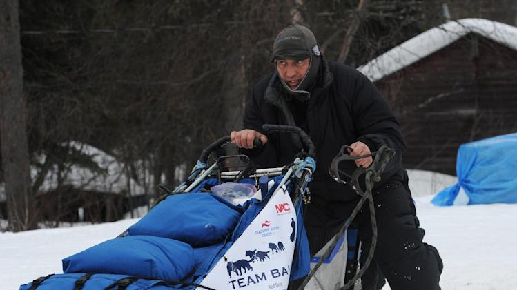 John Baker parks his dog team in  Anvik, Alaska on Friday, March 8, 2013,  during the Iditarod Trail Sled Dog Race. (AP Photo/Anchorage Daily News, Bill Roth)