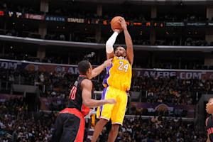 Lakers beat Raptors 118-116 in OT to go over .500