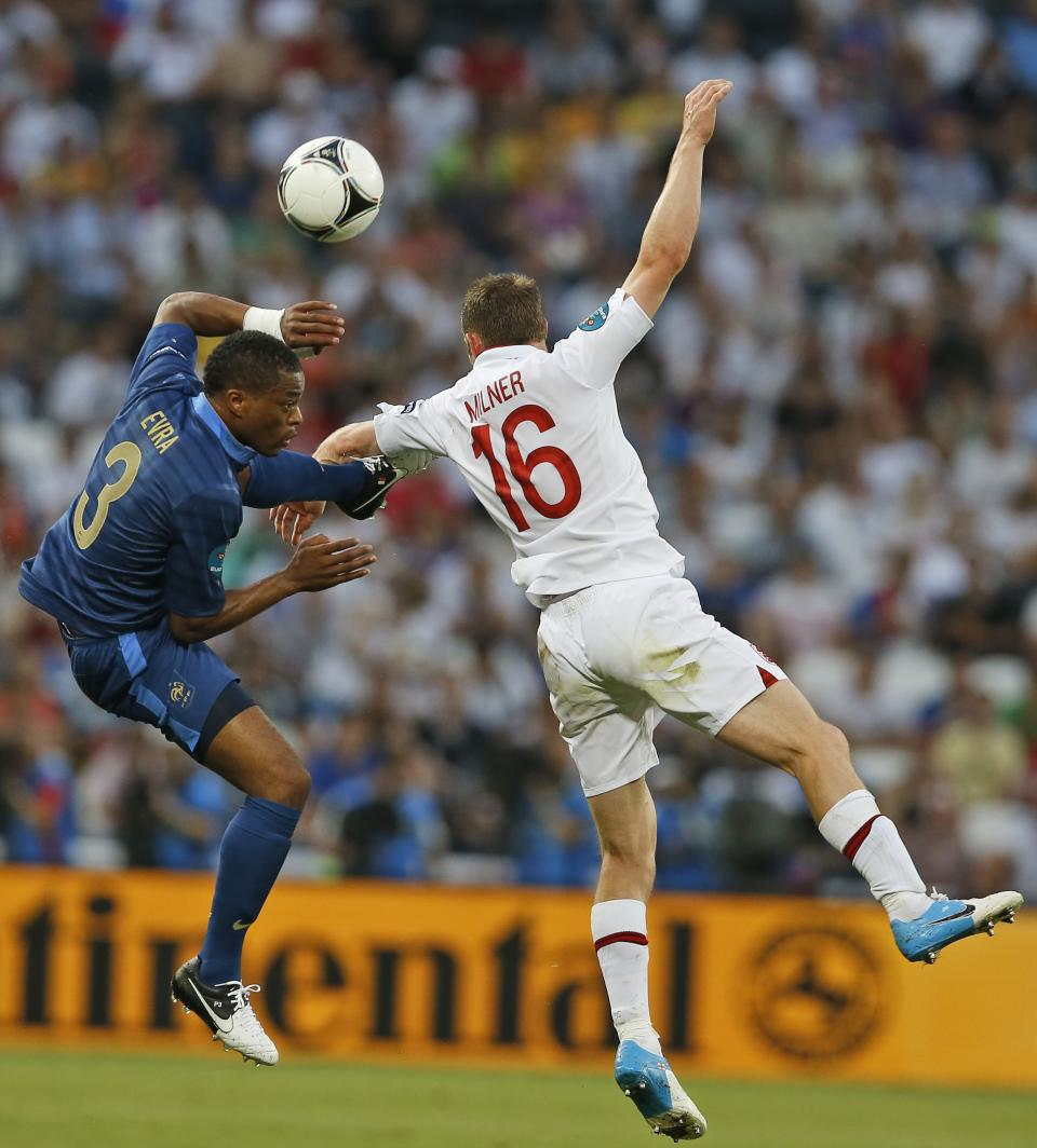 France's Patrice Evra and England's James Milner jumps for the ball during the Euro 2012 soccer championship Group D match between France and England in Donetsk, Ukraine, Monday, June 11, 2012. (AP Photo/Kirsty Wigglesworth)
