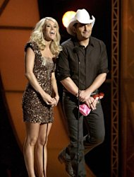 FILE - In this Nov. 9, 2011 file photo hosts Carrie Underwood, left, and Brad Paisley speak during the 45th Annual CMA Awards in Nashville, Tenn. The former American Idol winner&#39;s latest album Blown Away was a multi-week No. 1 on the country albums chart, she&#39;s in the midst of an arena tour and she also is up for female vocalist of the year at the CMA Awards, on Thursday, Nov. 1, 2012, airing live on ABC at 8 p.m. EDT from Nashville&#39;s Bridgestone Arena. (AP Photo/Mark Humphrey, File)