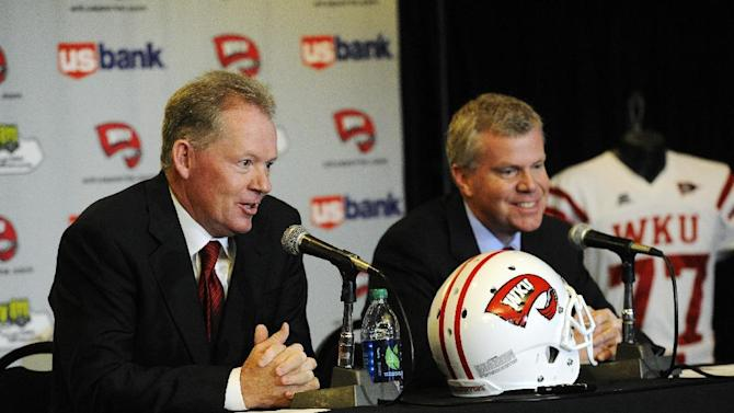 "New Western Kentucky head coach Bobby Petrino, left, responds to a question as athletic director Todd Stewart smiles during an NCAA college football news conference, Monday, Dec. 10, 2012, in Bowling Green, Ky. The 51-year-old was fired by Arkansas in April for a ""pattern of misleading"" behavior following an accident in which the coach was injured while riding a motorcycle with his mistress as a passenger but now wants to make the most of his second chance. (AP Photo/The Daily News, Joe Imel)"