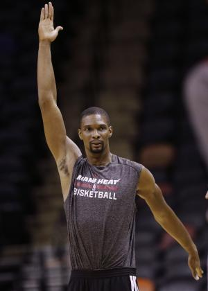 Miami Heat center Chris Bosh warms up during basketball practice on Wednesday, June 4, 2014 in San Antonio. They play Game 1 of the NBA Finals against the San Antonio Spurs on Thursday. (AP Photo/Eric Gay)