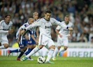 Real Madrid's Cristiano Ronaldo kicks a penalty shot during their Spanish League match against Deportivo on September 30. The visitors took a shock lead after 15 minutes through Riki but Madrid quickly bounced back with Ronaldo hitting his first from the penalty spot